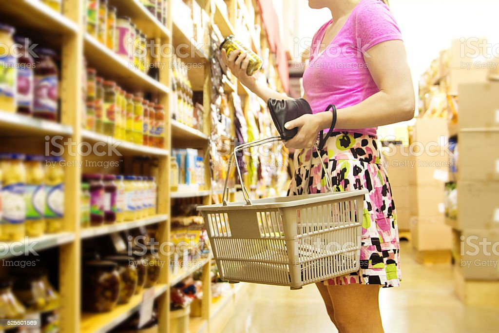 Woman Shopper Shopping in Supermarket Grocery Store Making Choices, Selections stock photo