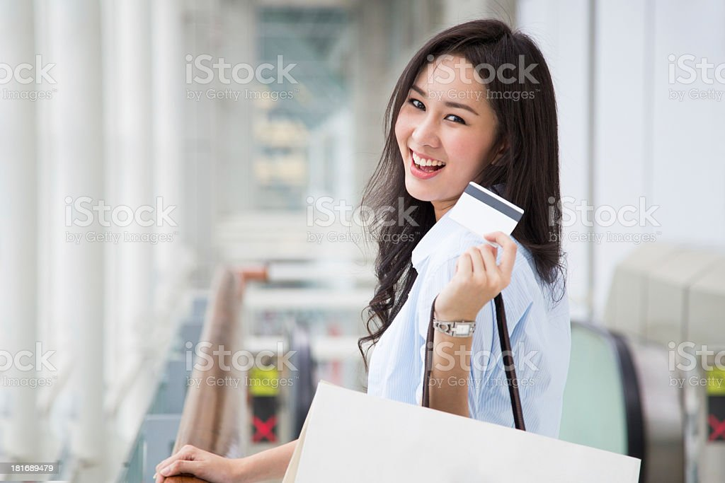 Woman shopping and showing a credit card royalty-free stock photo