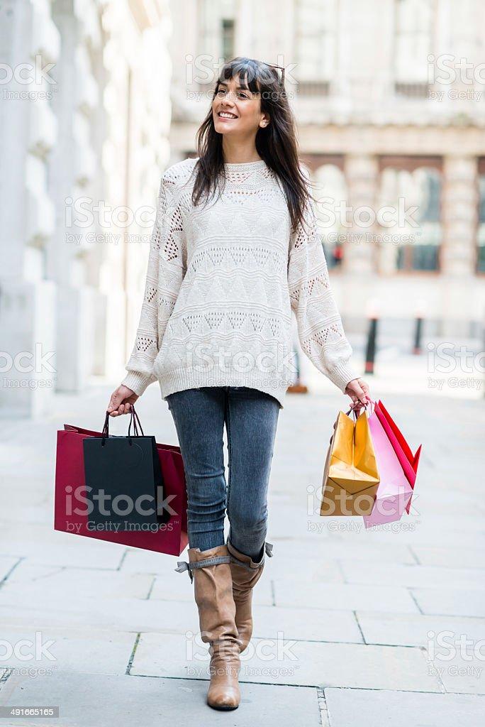 Woman shopping and walking stock photo