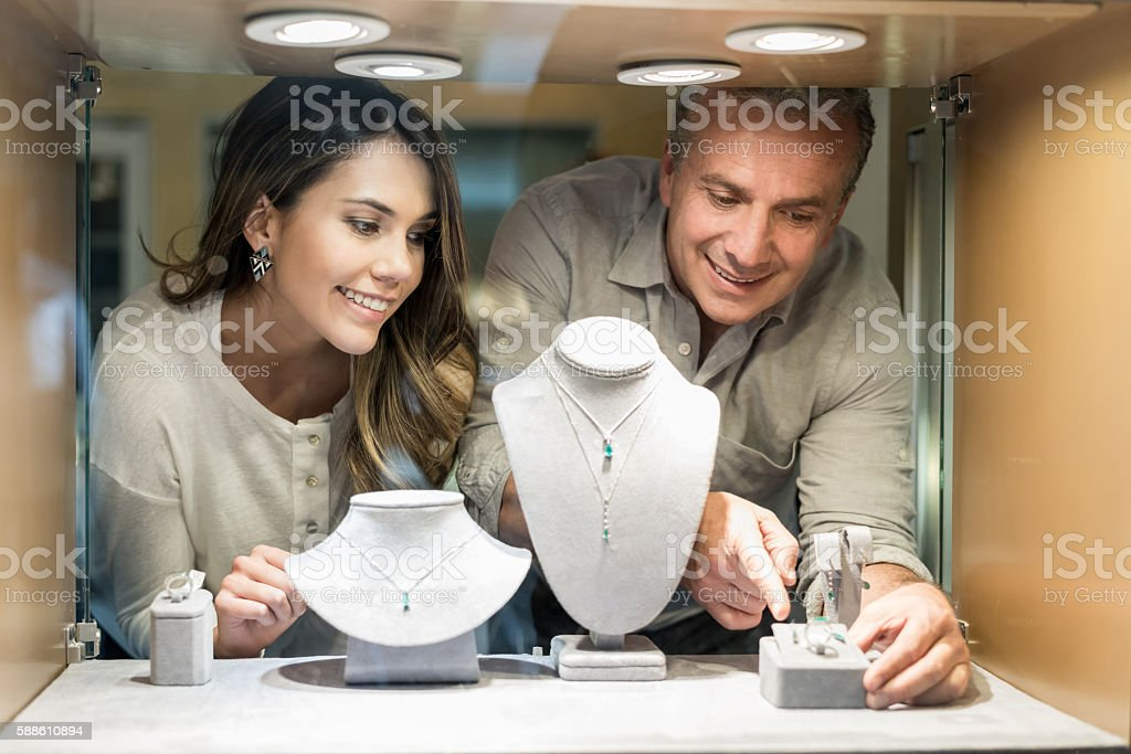 Woman shopping at a jewelry store stock photo