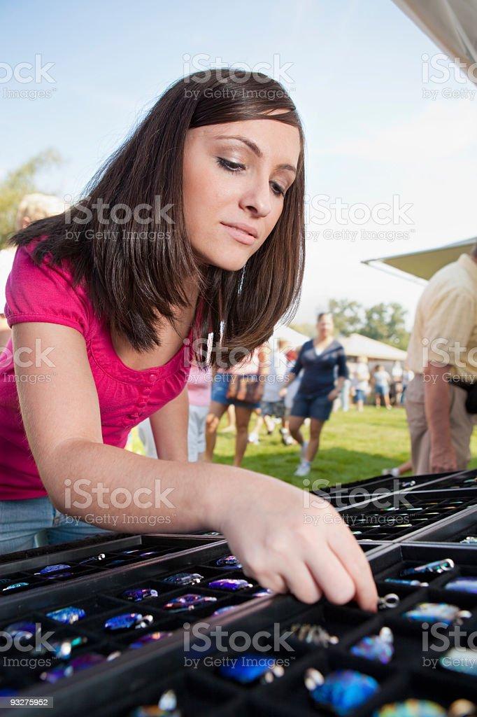 Woman Shopping at an Arts and Crafts Fair royalty-free stock photo