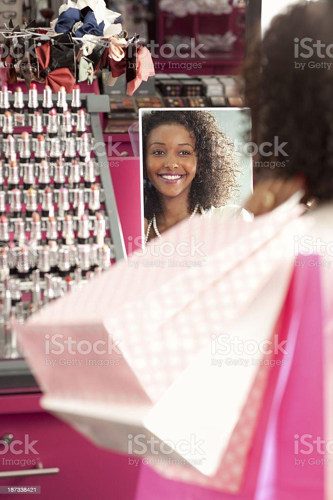Woman shopping at cosmetics store. stock photo