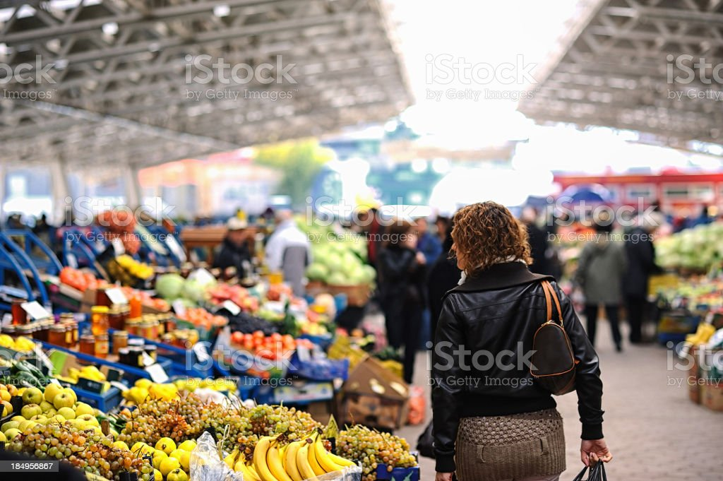 Woman shopping at farmer's market stock photo