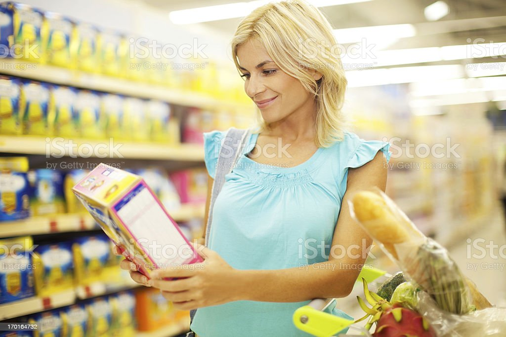 Woman shopping cereals. royalty-free stock photo