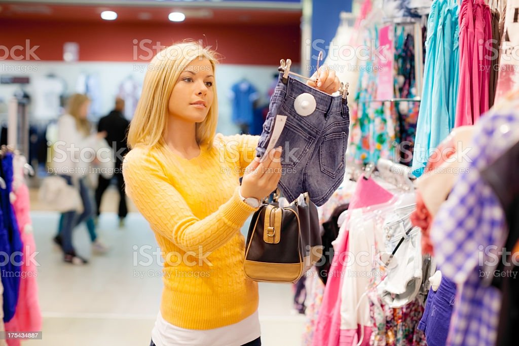 Woman shopping clothes. royalty-free stock photo
