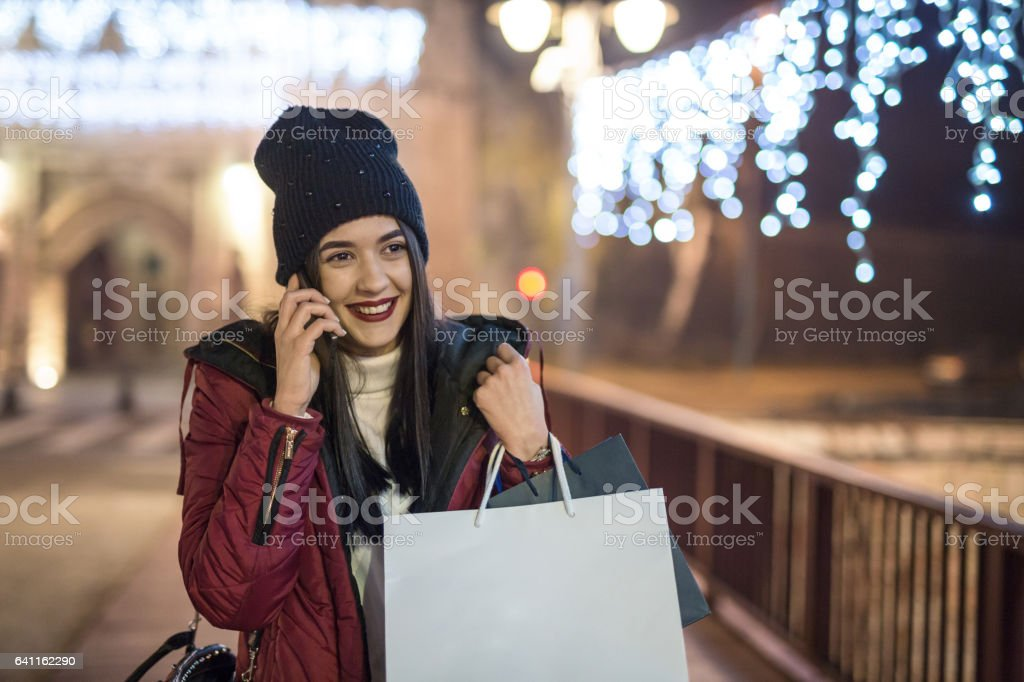 Woman shopping during Christmas holidays stock photo