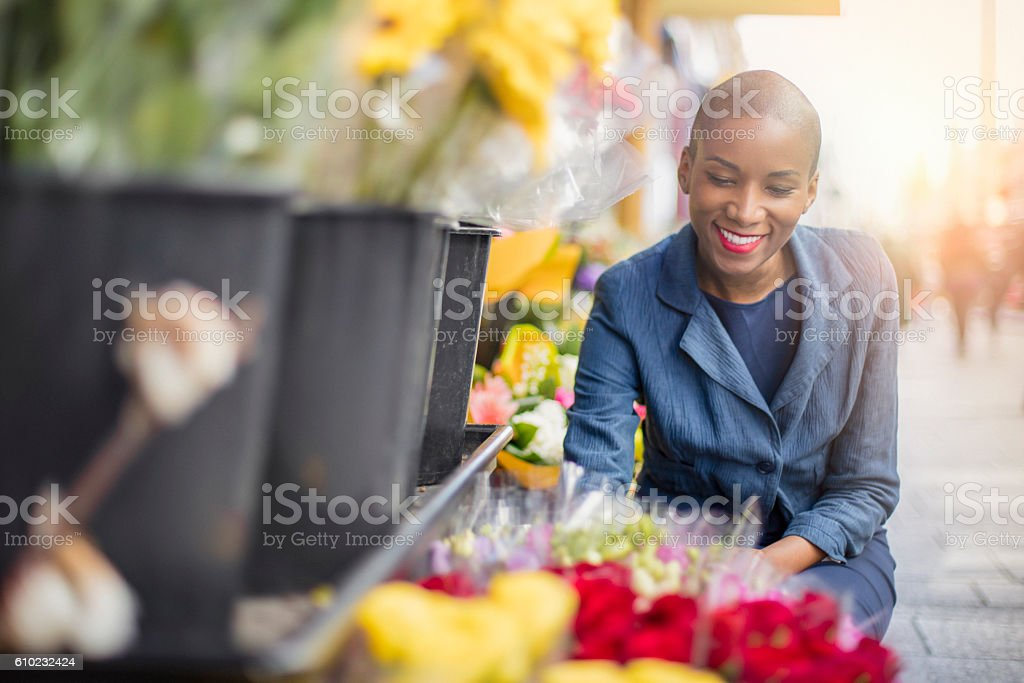 Woman shopping flowers in the streets of Paris at sunset stock photo
