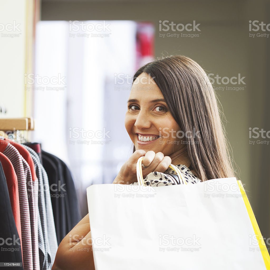 Woman shopping for clothes and carring a bag. royalty-free stock photo