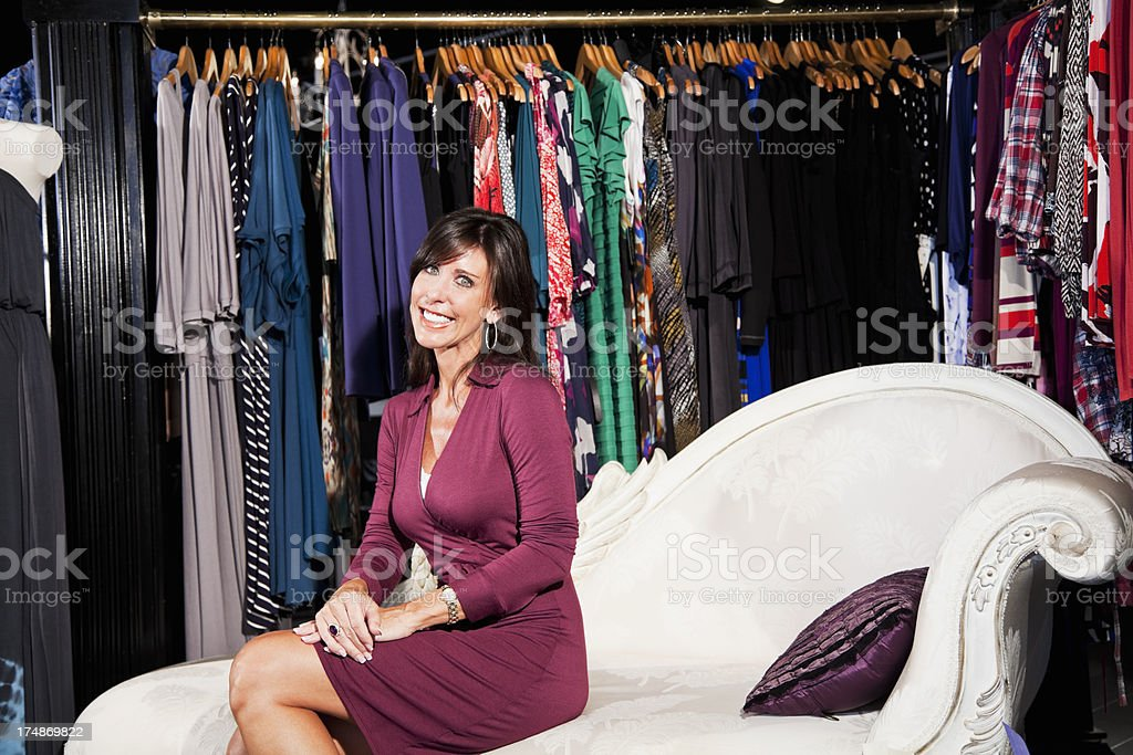 Woman shopping for clothing royalty-free stock photo