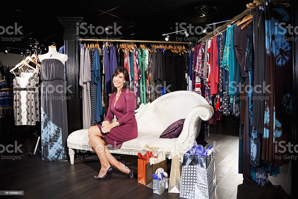 Woman shopping for clothing stock photo