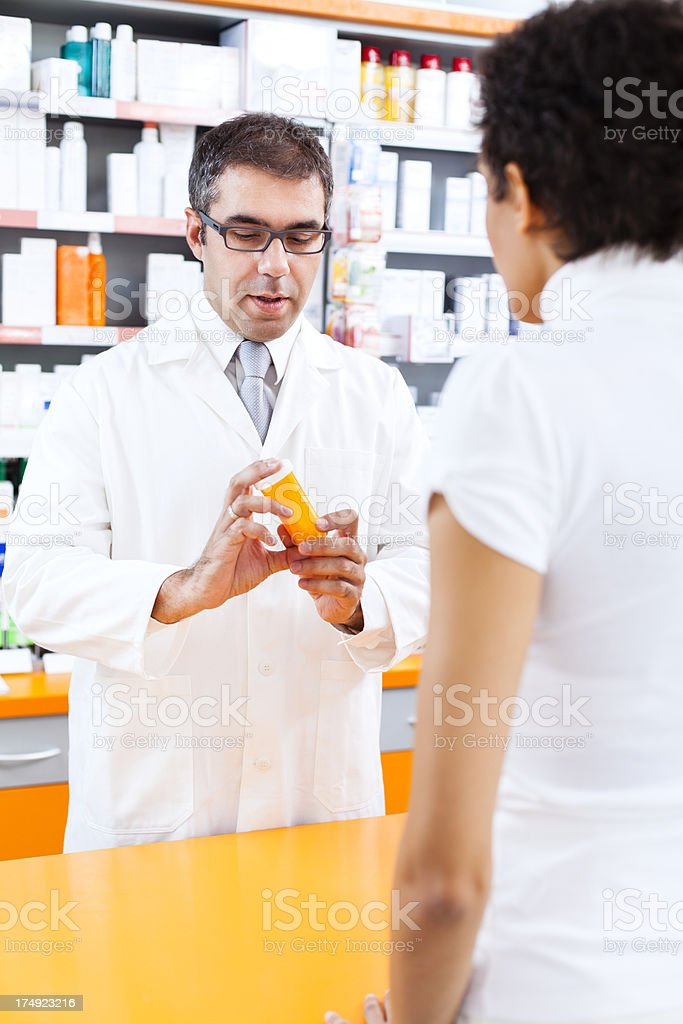 Woman shopping for drugs in the pharmacy royalty-free stock photo