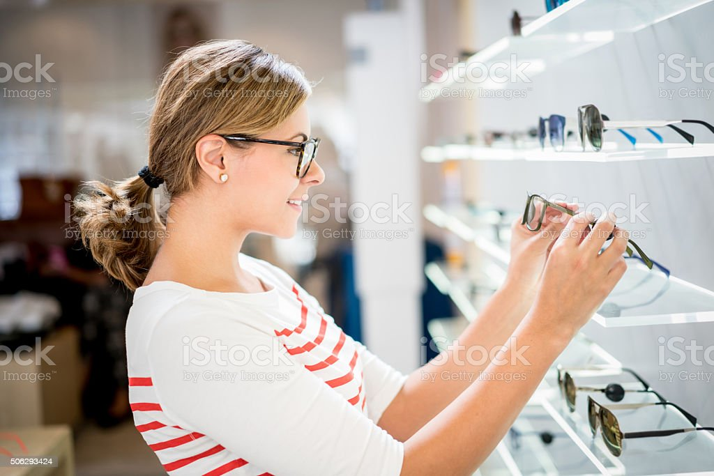 Woman shopping for glasses at the optics stock photo