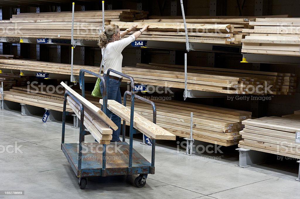 Woman shopping for lumber stock photo