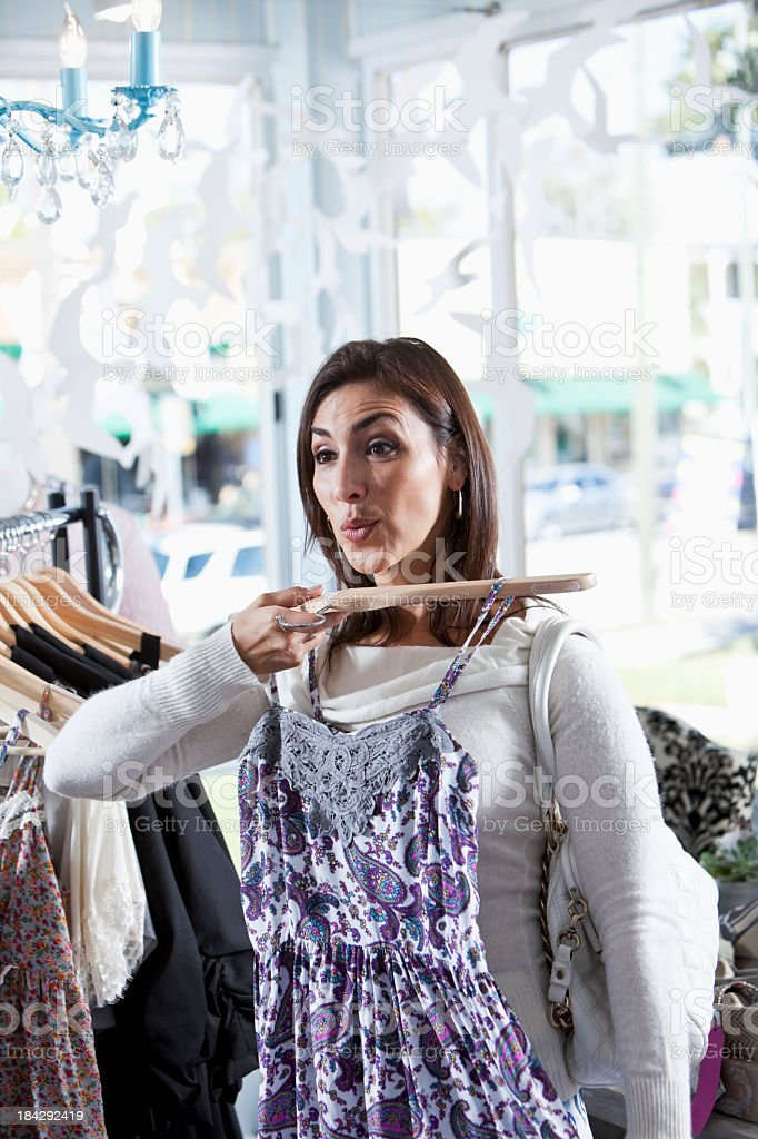 Woman shopping for new clothes stock photo