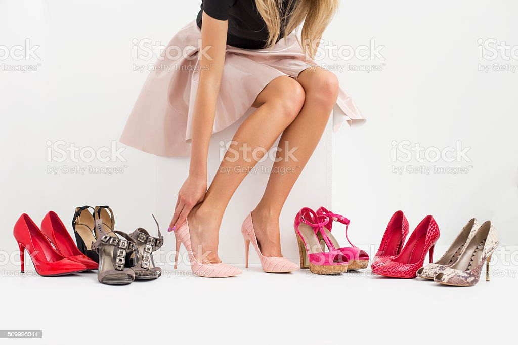 Woman shopping for new shoes stock photo