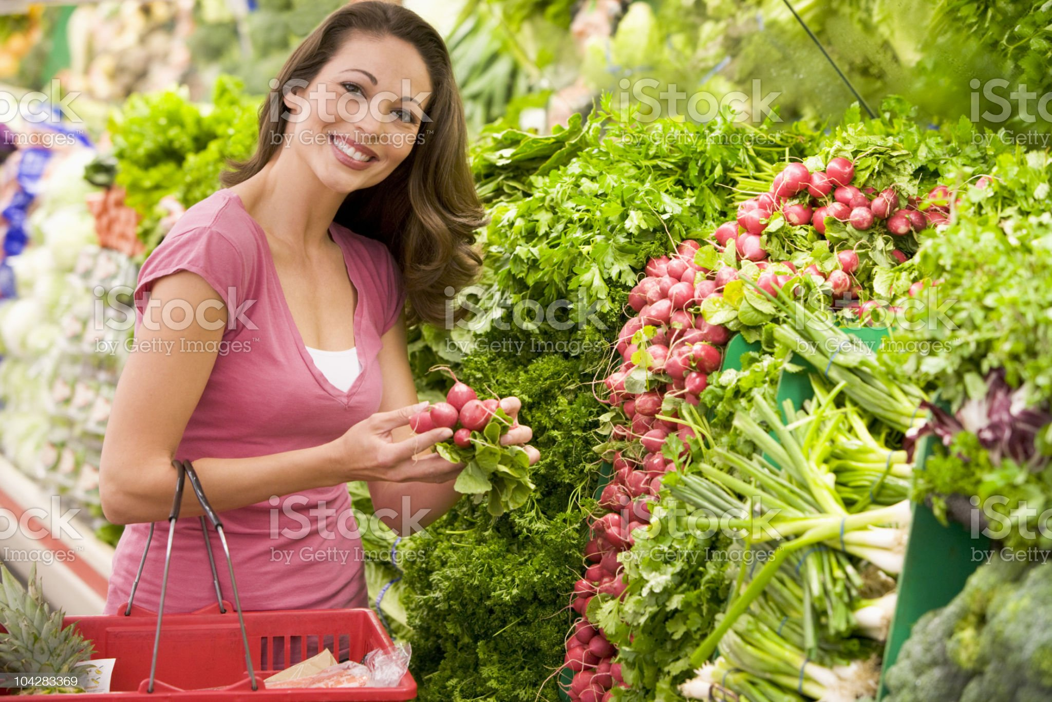 Woman shopping for produce in supermarket royalty-free stock photo