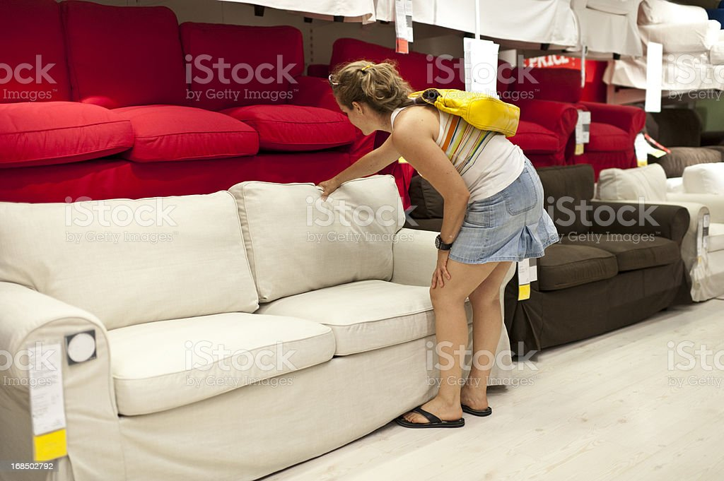 Woman Shopping for sofa royalty-free stock photo