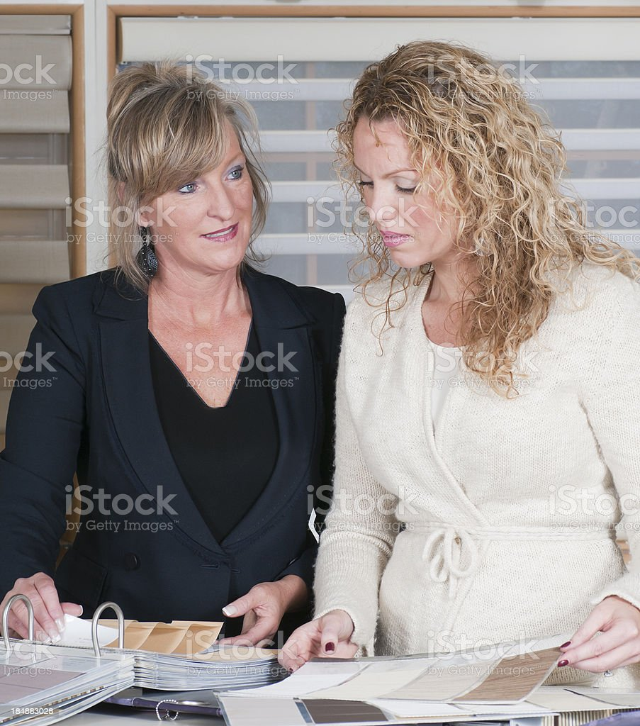 Woman Shopping for Window Shades royalty-free stock photo