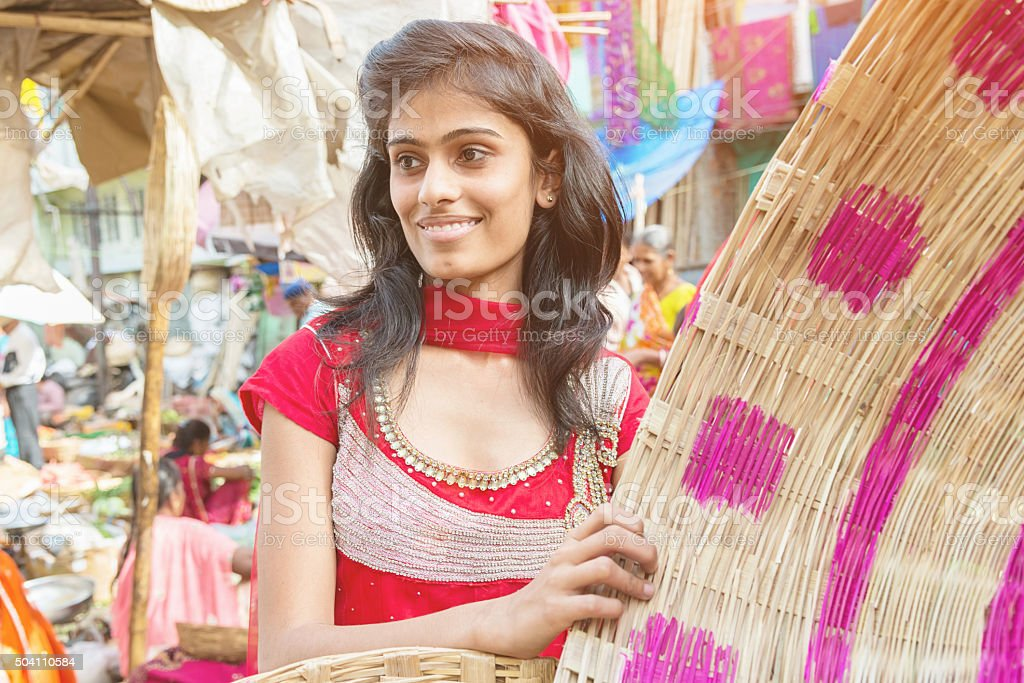 Woman shopping handmade baskets at street market in India stock photo