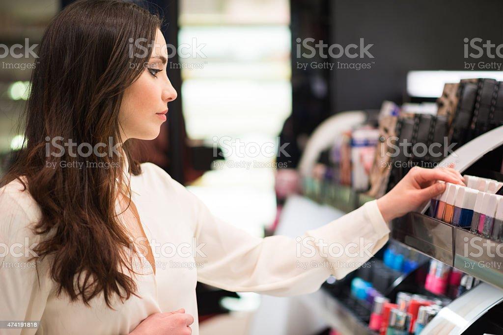 Woman shopping in a beauty shop stock photo