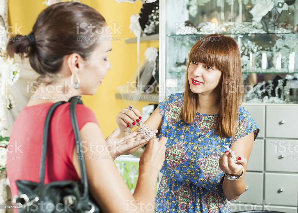 Woman shopping in a jewelry boutique royalty-free stock photo
