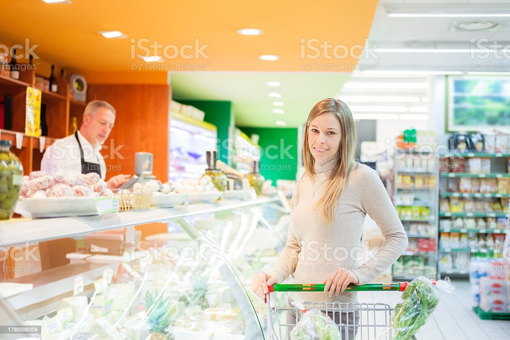 Woman shopping in a supermarket royalty-free stock photo