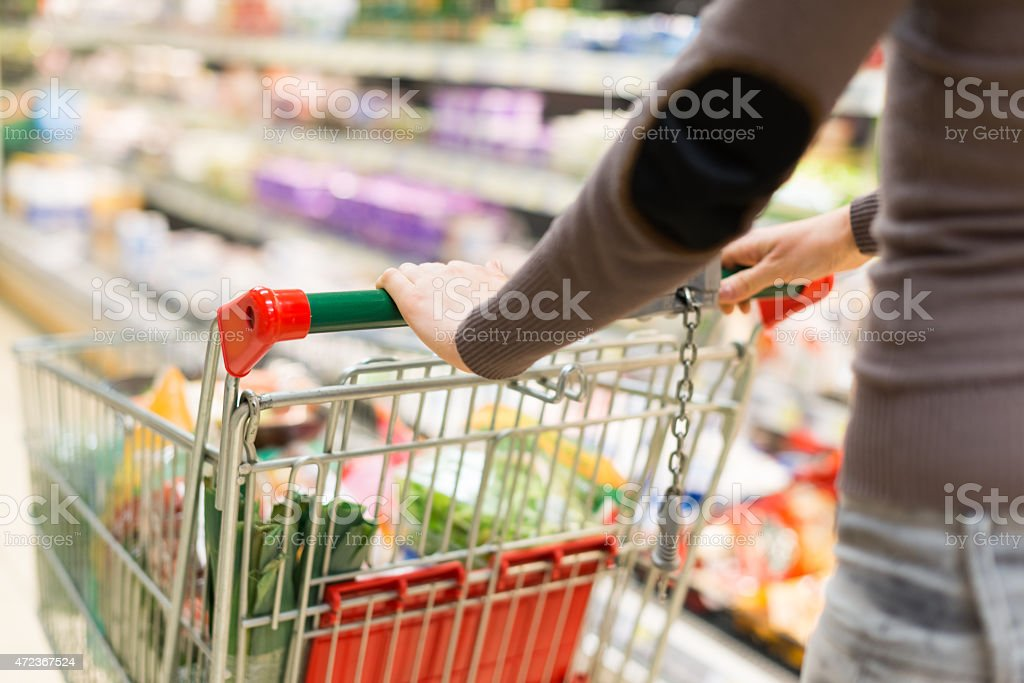 Woman shopping in a supermarket stock photo
