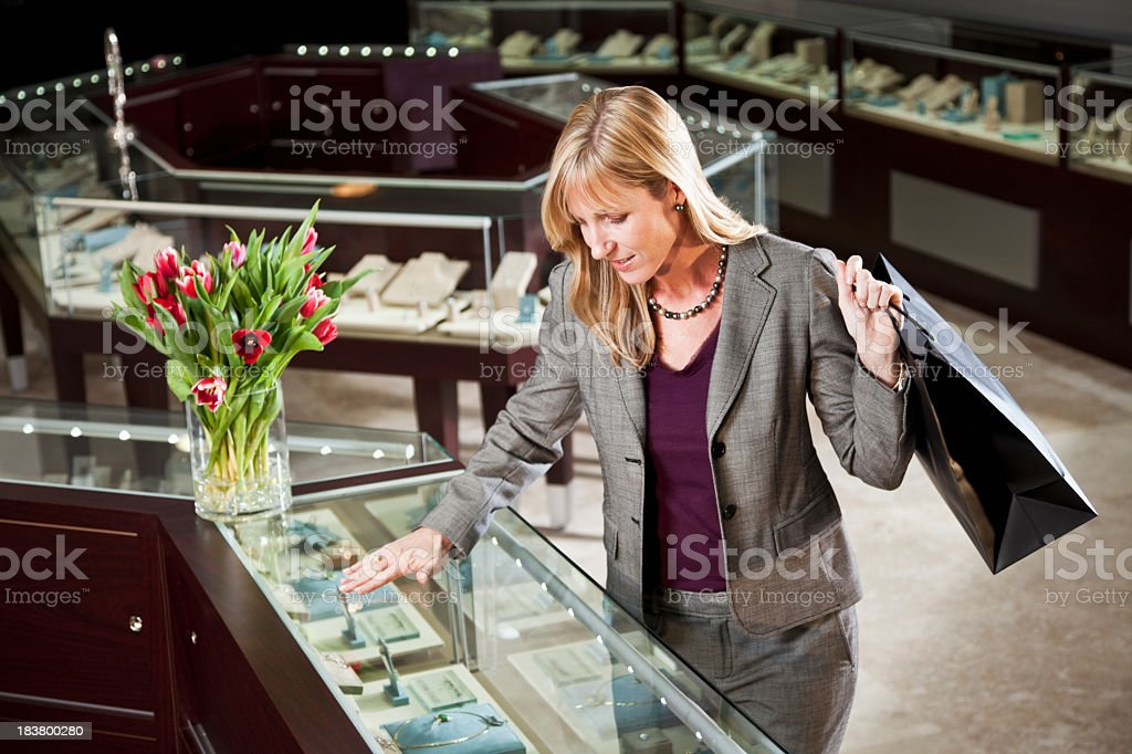 Woman shopping in jewelry store royalty-free stock photo