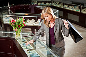 Woman shopping in jewelry store