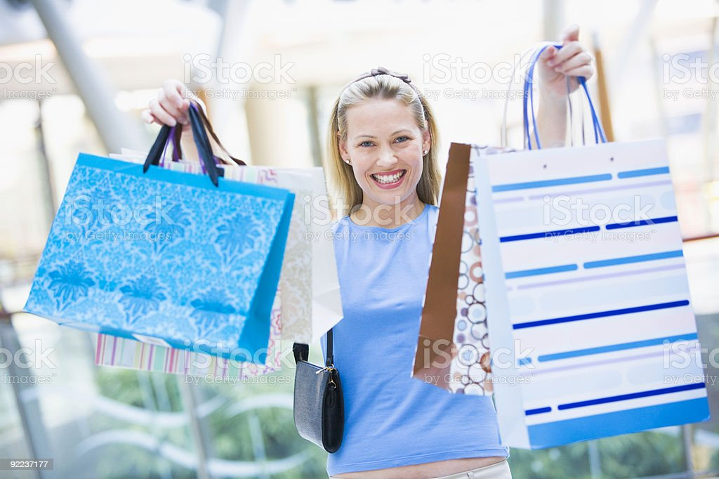 Woman shopping in mall royalty-free stock photo
