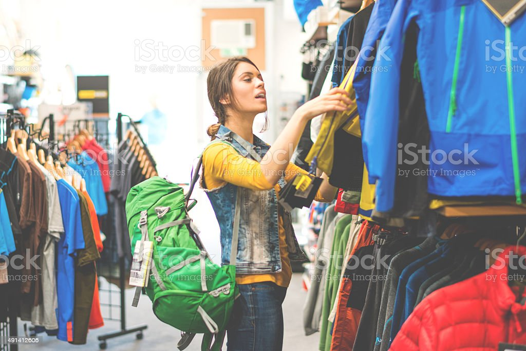 Woman shopping in outdoor equipment mega store stock photo