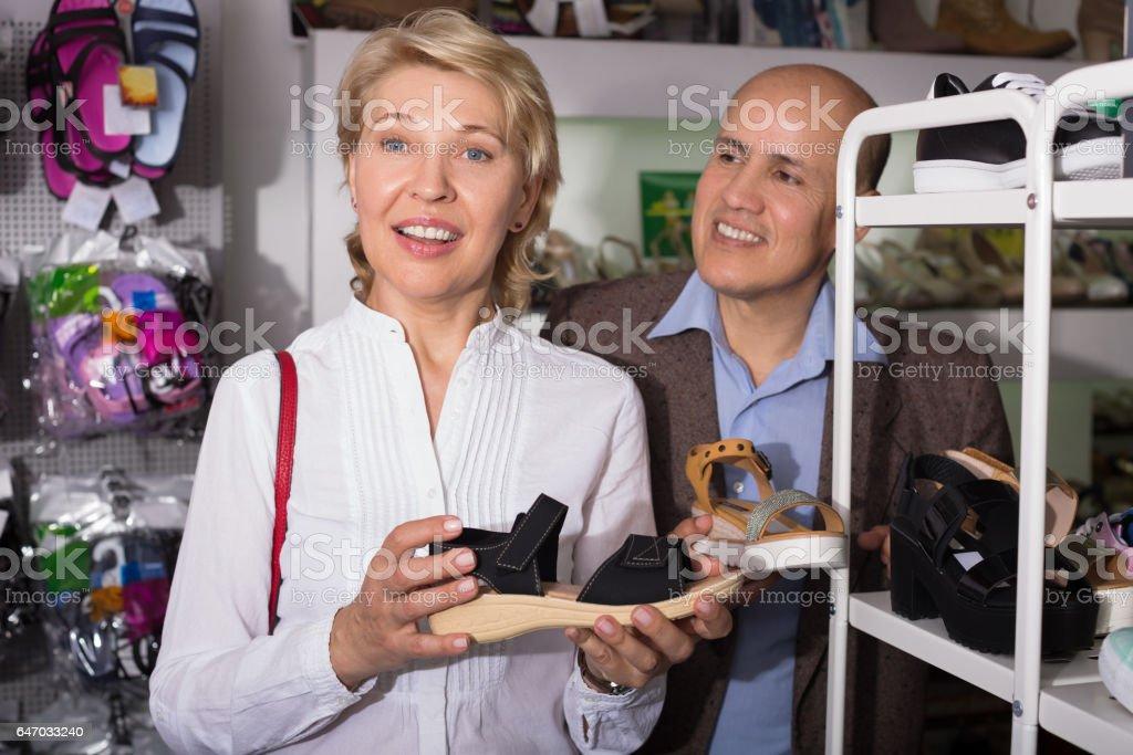 Woman shopping in shoe shop stock photo