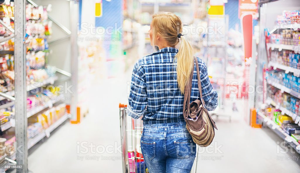 Woman shopping in supermarket. stock photo