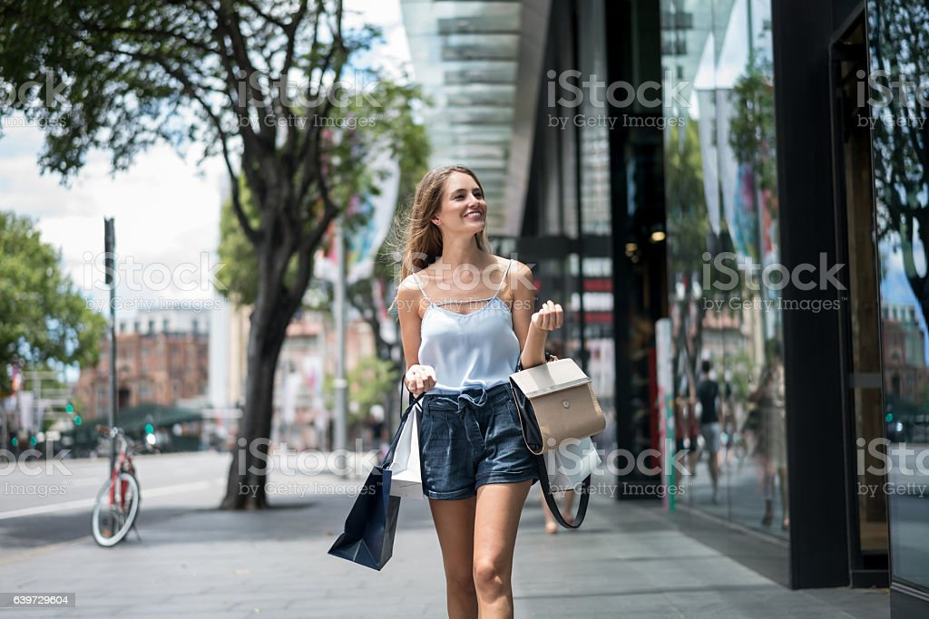 Woman shopping on the street stock photo