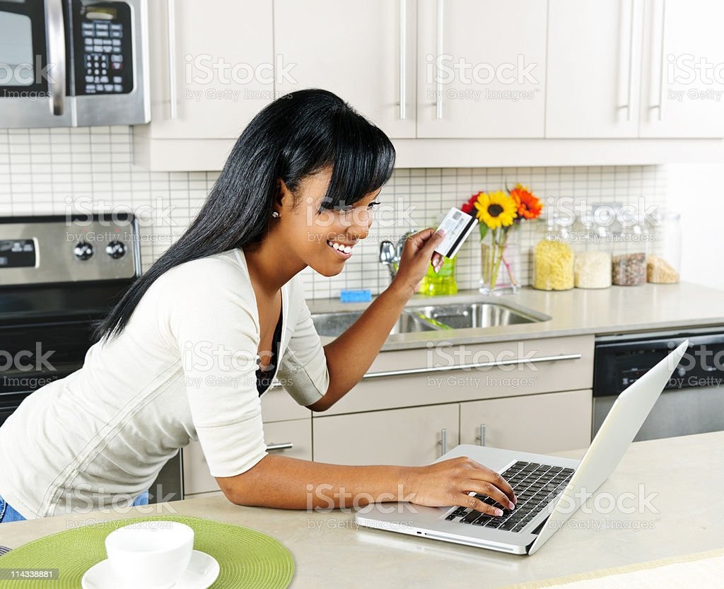 Woman shopping online at home royalty-free stock photo