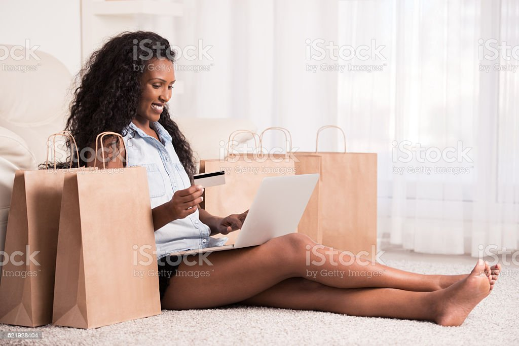 Woman shopping online at home. stock photo