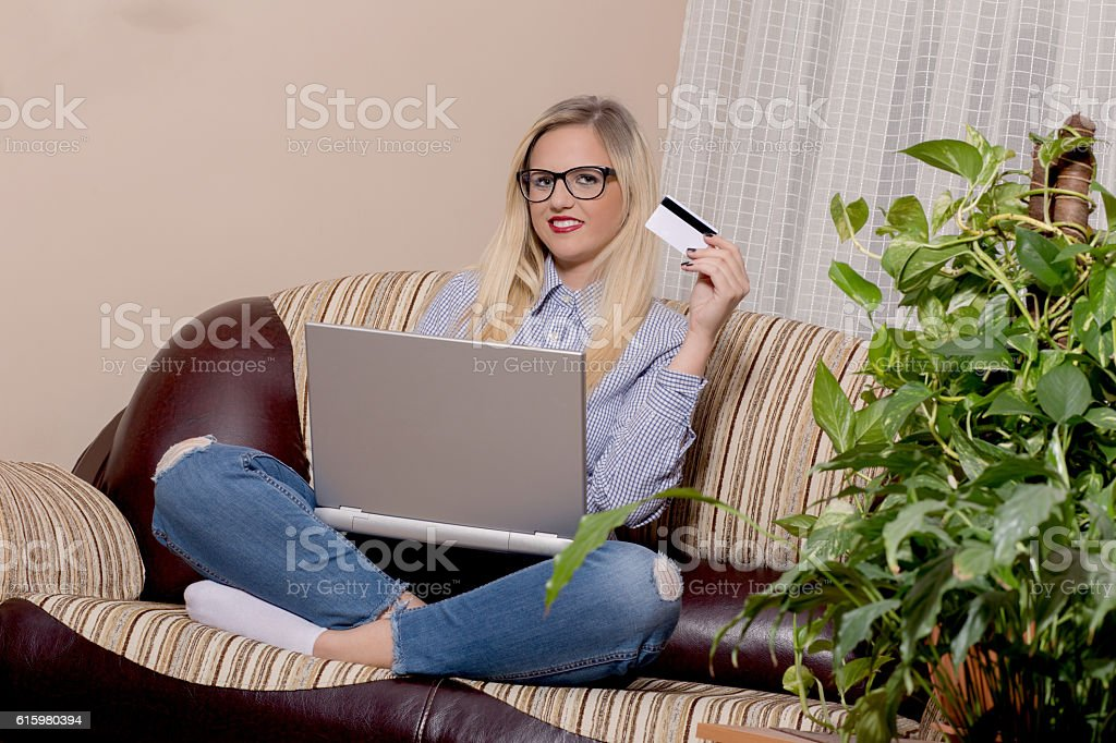 Woman shopping online stock photo