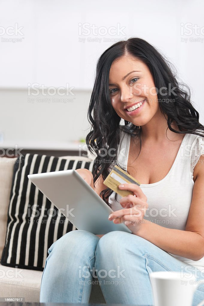 Woman shopping online using a digital tablet royalty-free stock photo