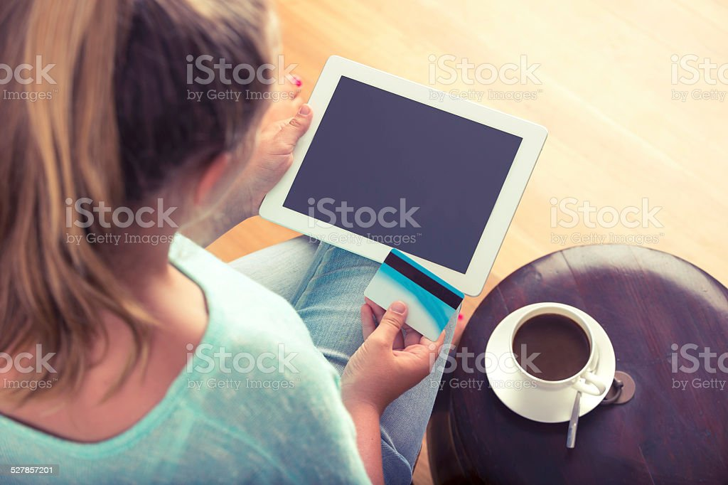 Woman shopping online with digital tablet and credit card stock photo