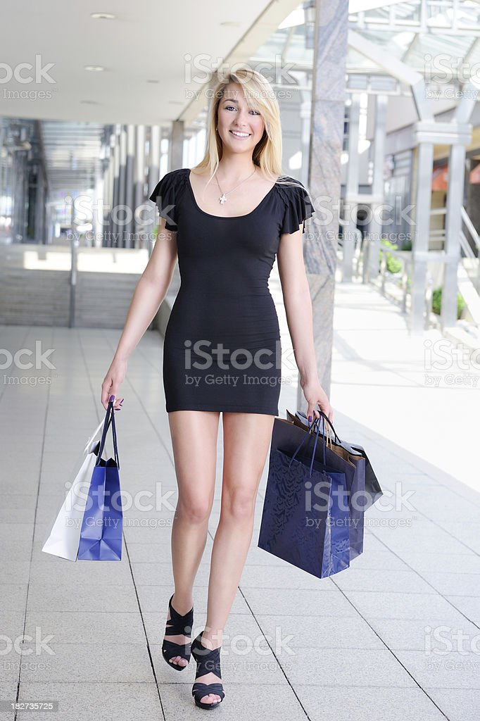 Woman shopping - perfect candid smile royalty-free stock photo
