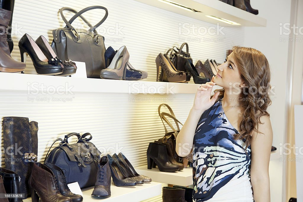 Woman shopping shoes royalty-free stock photo