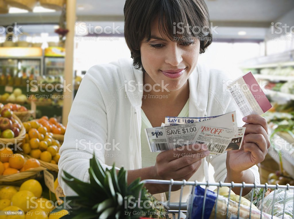Woman shopping with coupons stock photo