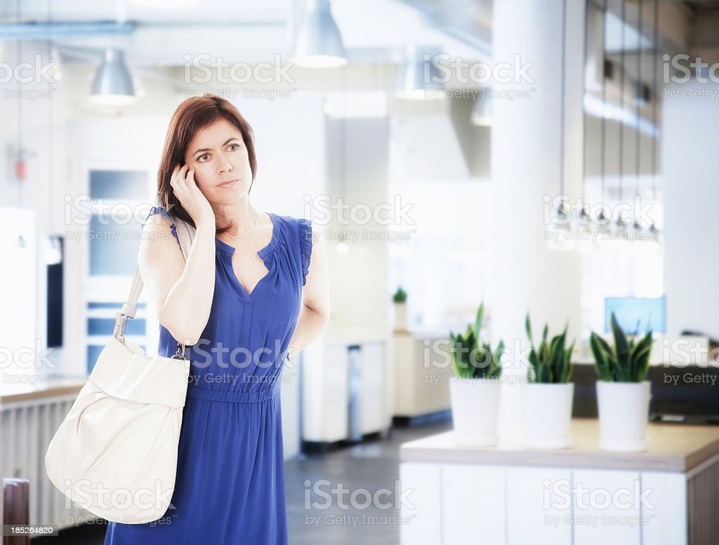 Woman shopping with phone royalty-free stock photo