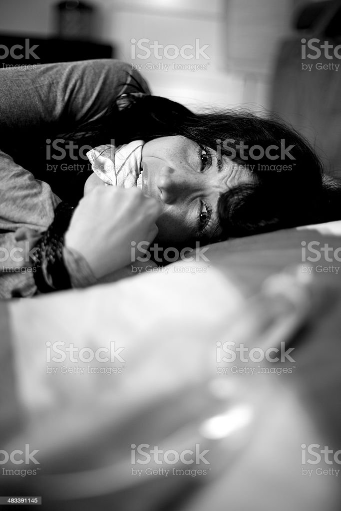 Woman shouting and crying in bed kidnapped stock photo