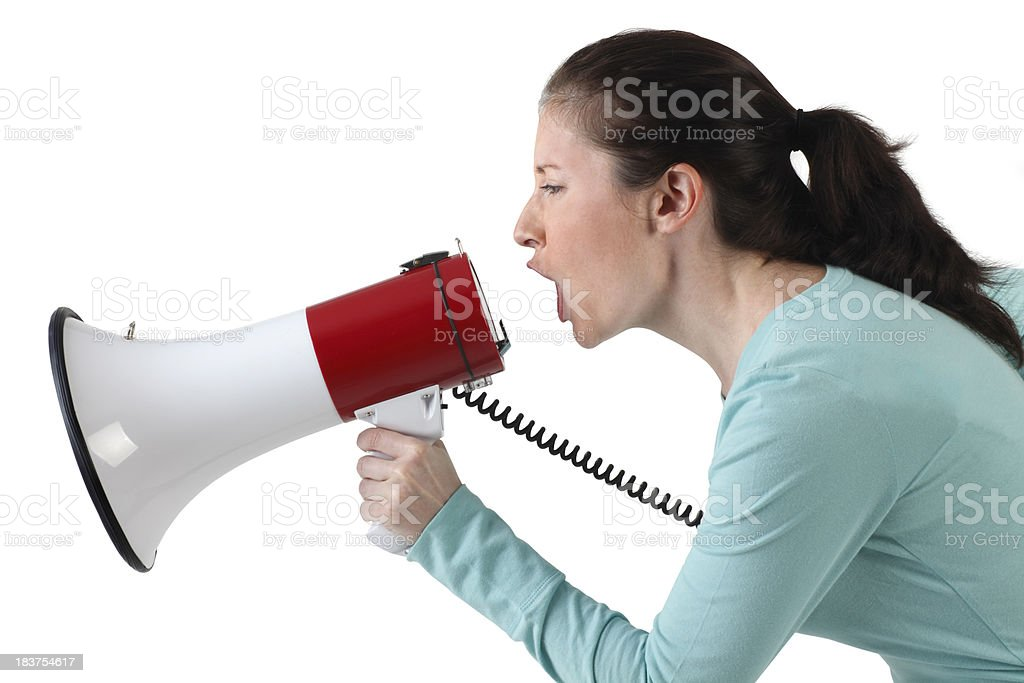 Woman Shouting Into Megaphone royalty-free stock photo