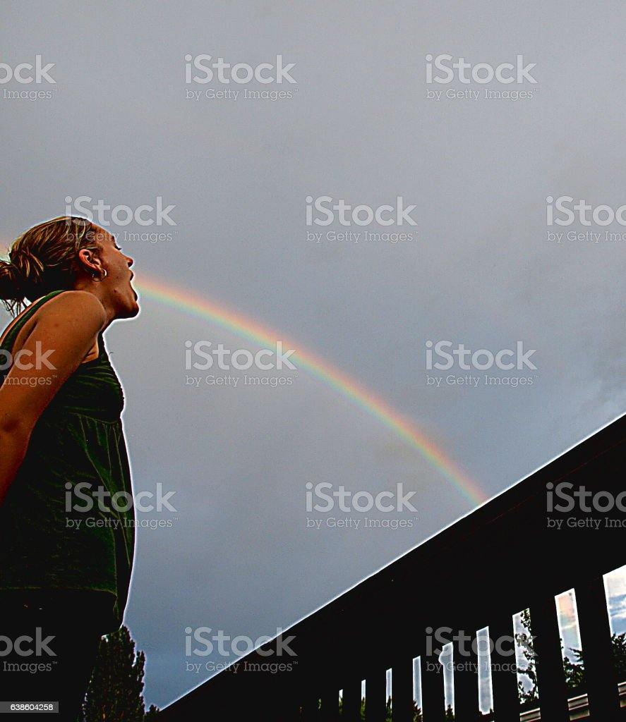 Woman shouting out a rainbow stock photo