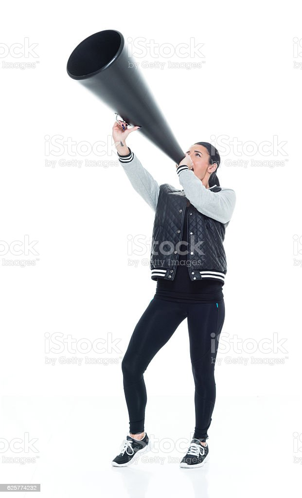 Woman shouting with megaphone stock photo