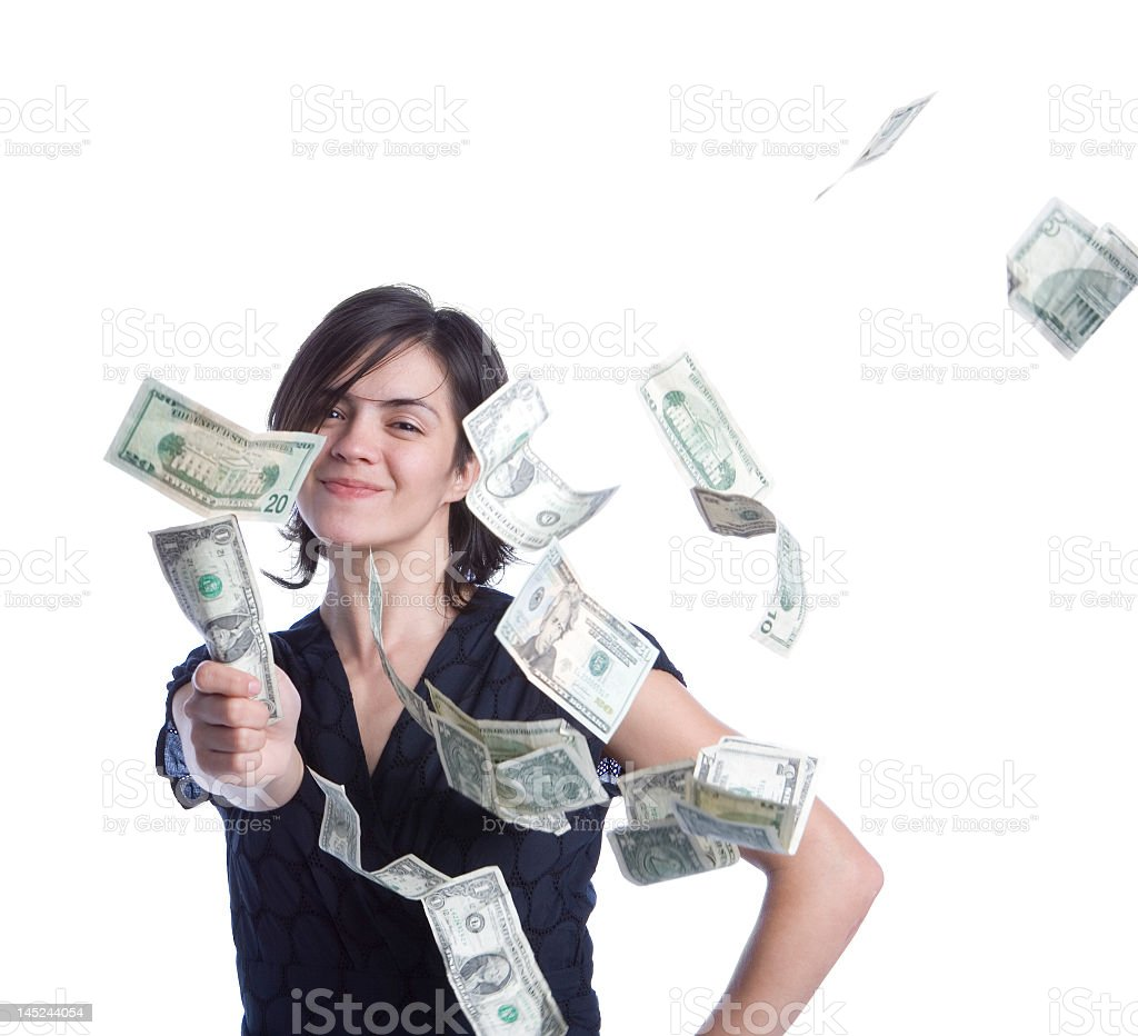 A woman showered in money while holding a dollar  stock photo