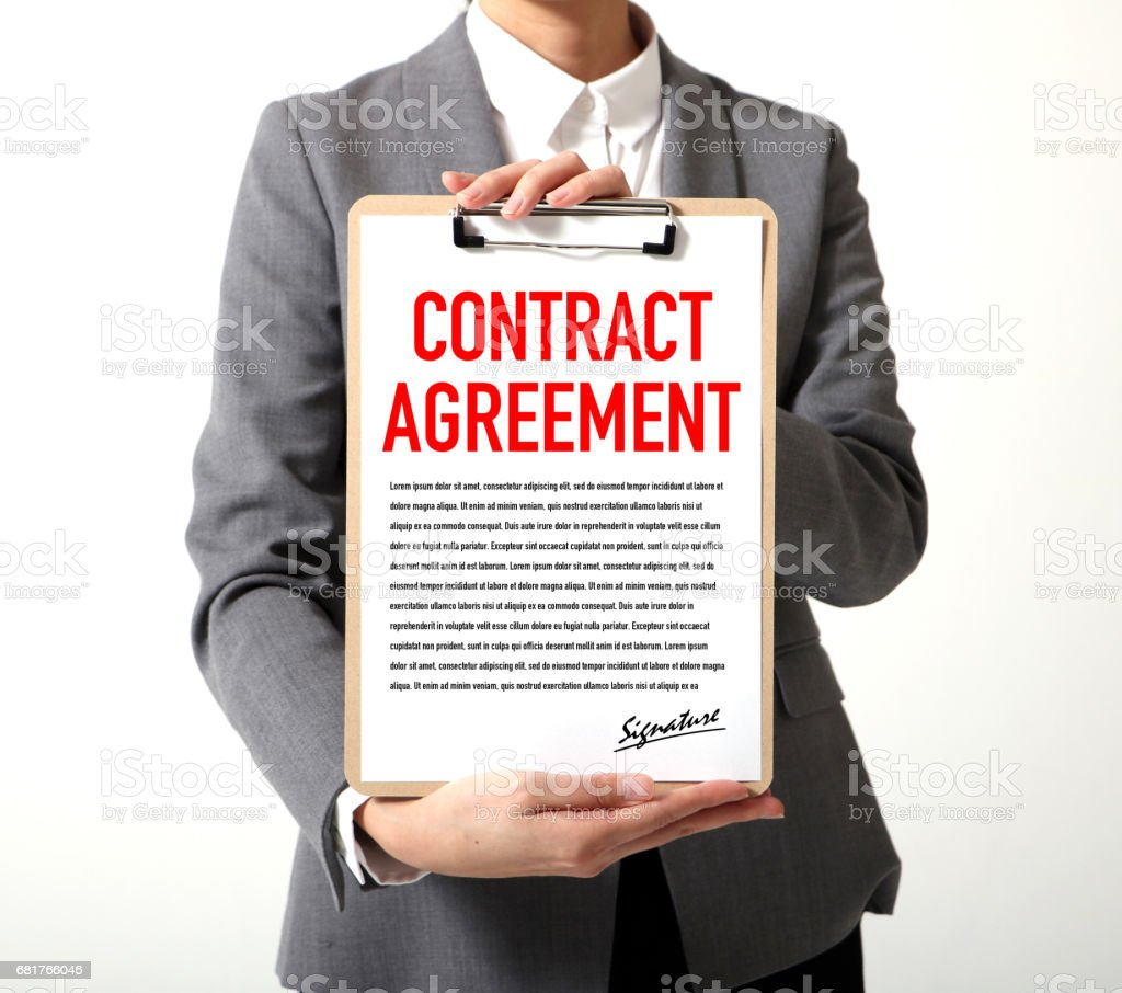 woman showing a written contract agreement stock photo