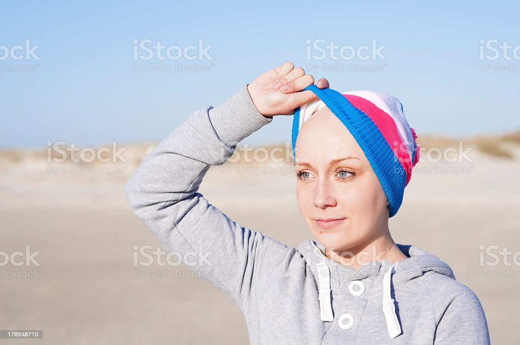 woman showing bald head - secondary effect of chemotherapy royalty-free stock photo